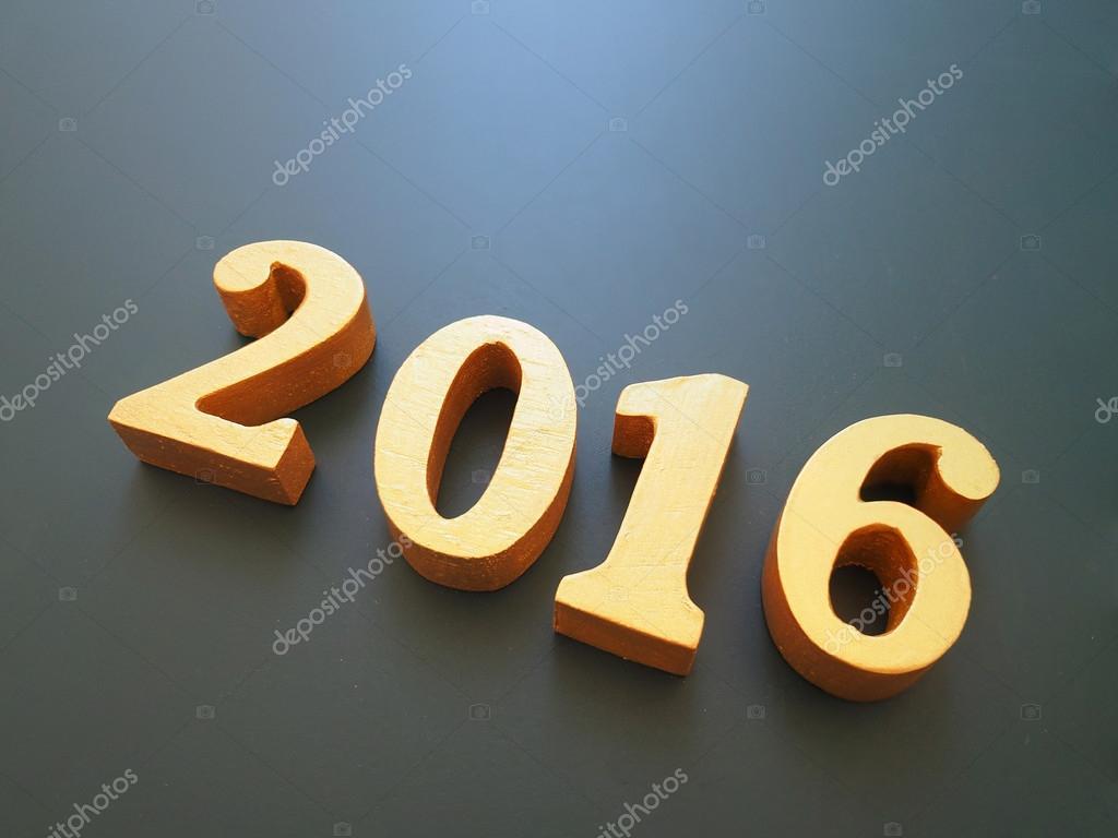 Jahr 2016, gold Holz 2016 Zahl auf schwarzem Hintergrund, frohes ...