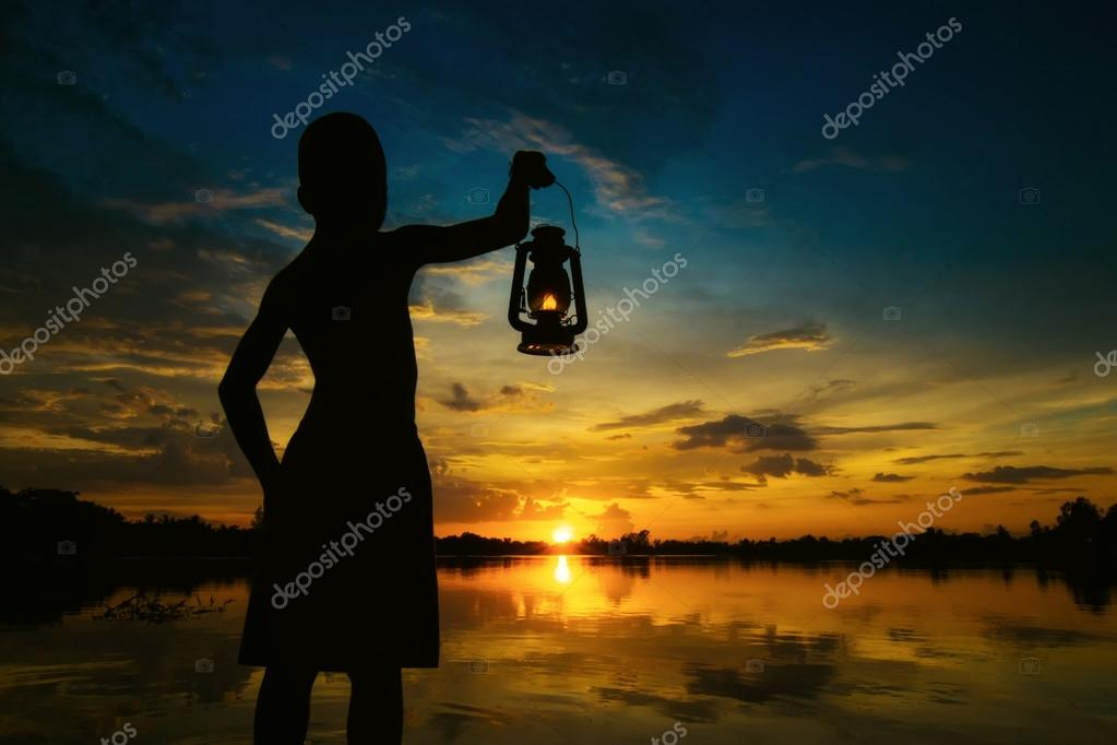 Boy Holding Lamp Looking For Sunset . Abstract Meaning Hope Of Life. U2014  Photo By Wichansumalee