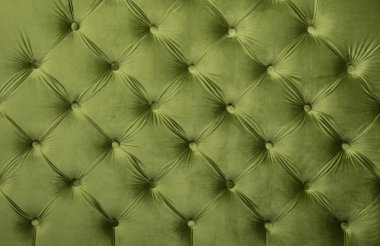 Green capitone tufted fabric upholstery texture