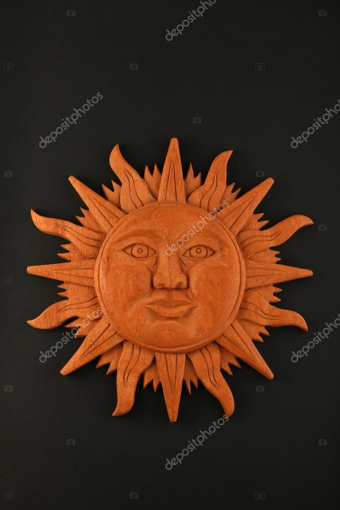 Mexican Wooden Carved Mayan Sun Symbol Plate Isolated On Black