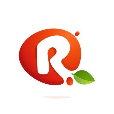 Letter R logo in fresh juice splash with green leaves.