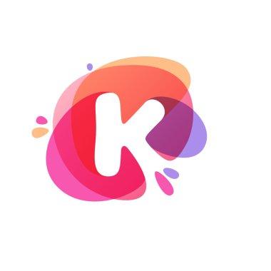 Letter K logo at colorful watercolor splash background.
