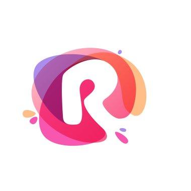 Letter R logo at colorful watercolor splash background.
