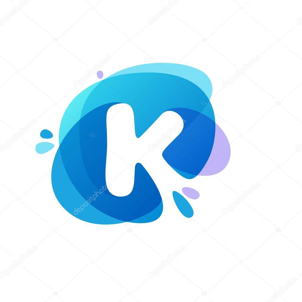 Letter K logo at blue water splash background.