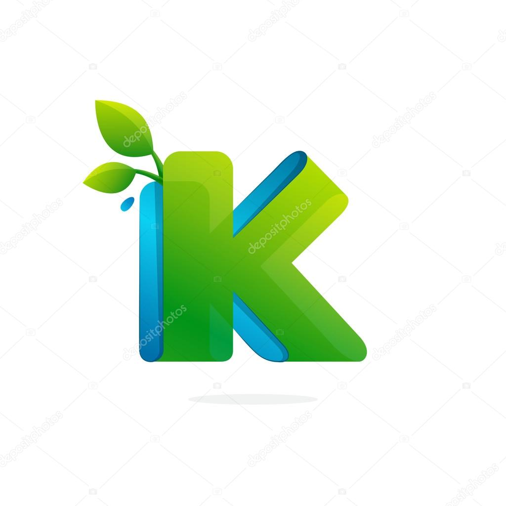 Letter K logo formed by ribbon with leaves and drops.