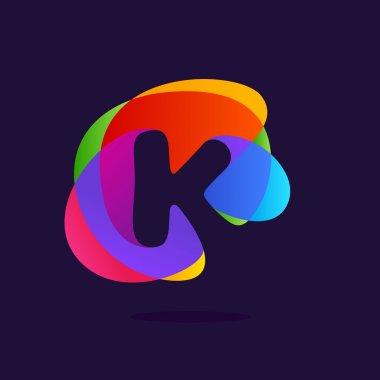 Letter K logo at colorful multicolor splash background.