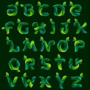 Alphabet letters formed by green leaves