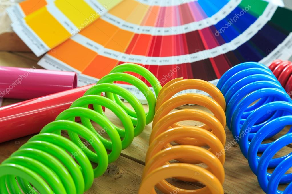 metal, car spring parts coated with powder coating and color chart on wooden background