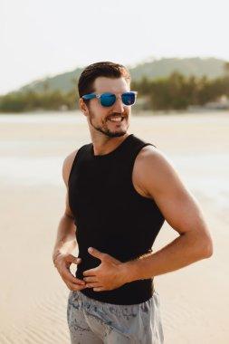 Handsome man at beach