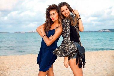 Beautiful happy stylish hipster girls