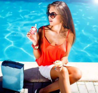 Beauty brunette girl at pool