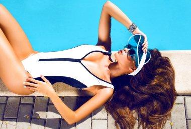 Beautiful girl in black bikini at pool