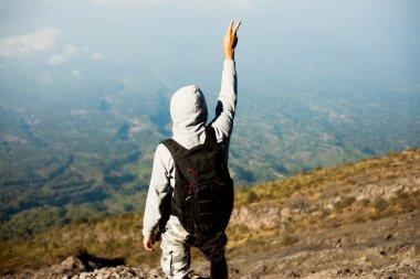 Man hiker looking at landmarks