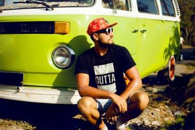 Hipster man at retro bus