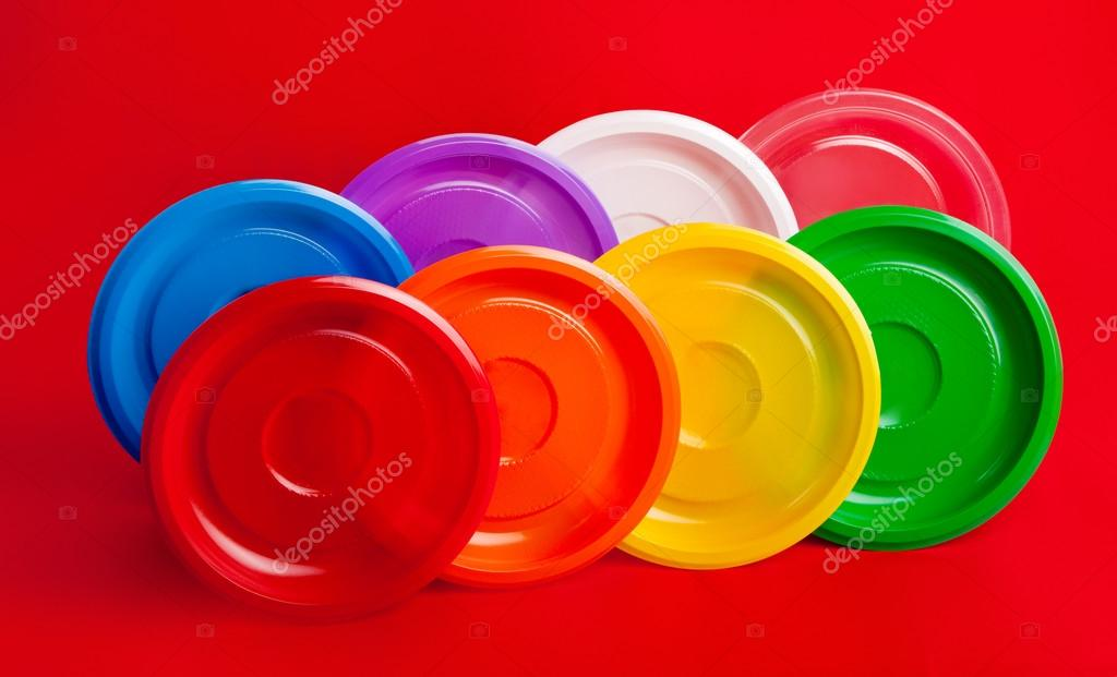 Colored plastic plates on red background u2014 Photo by lobur  sc 1 st  Depositphotos & Colored plastic plates on red background u2014 Stock Photo © lobur ...