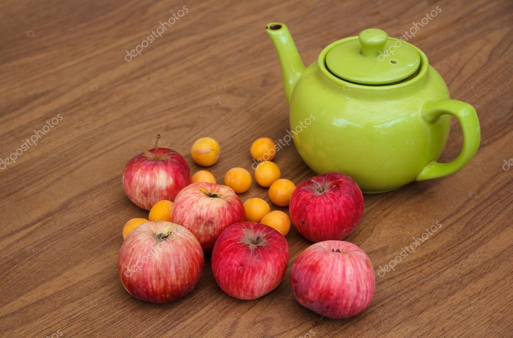 Green tea on the table with apples