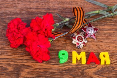 Carnations, medals, the inscription