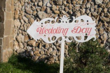 Wedding decor. Wooden plaque with the inscription Wedding. Weddi