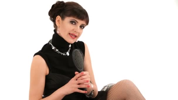 Girl In The Black Dress Singing And Uusing A Comb As A Microphone.