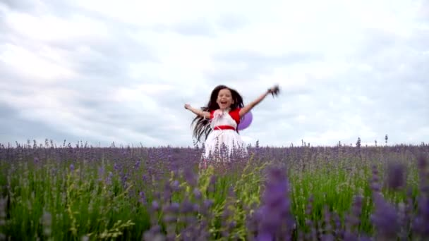 Cheerful girl jumping in lavender