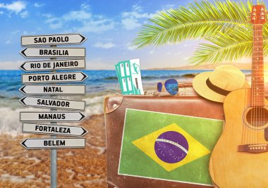 Concept of summer traveling with old suitcase and Brazil town sign with burning sun