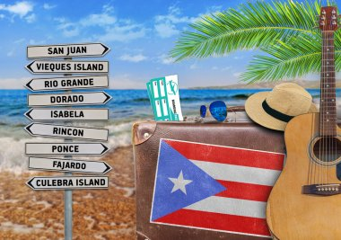 Concept of summer traveling with old suitcase and Puerto Rico town sign