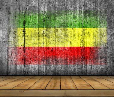 Rasta flag painted on background texture gray concrete with wooden floor