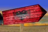 Albania Flag wooden sign with beach background