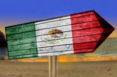 Mexico Flag wooden sign on beach background