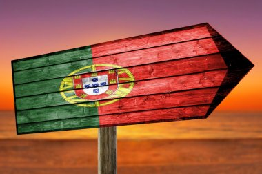 Portugal Flag on wooden table sign on beach background