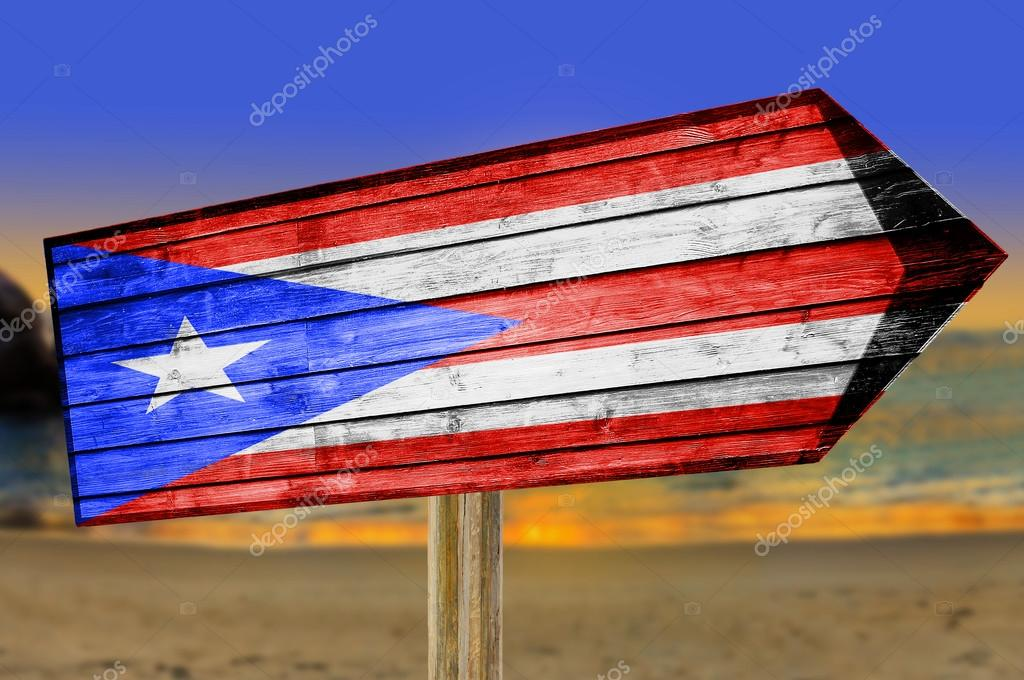 Puerto Rico Flag Wooden Sign With Beach Background Stock Photo