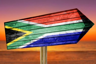 South Africa wooden sign on beach background