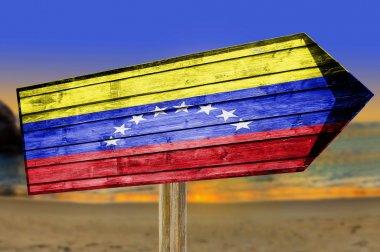 Venezuela Flag wooden sign on beach background