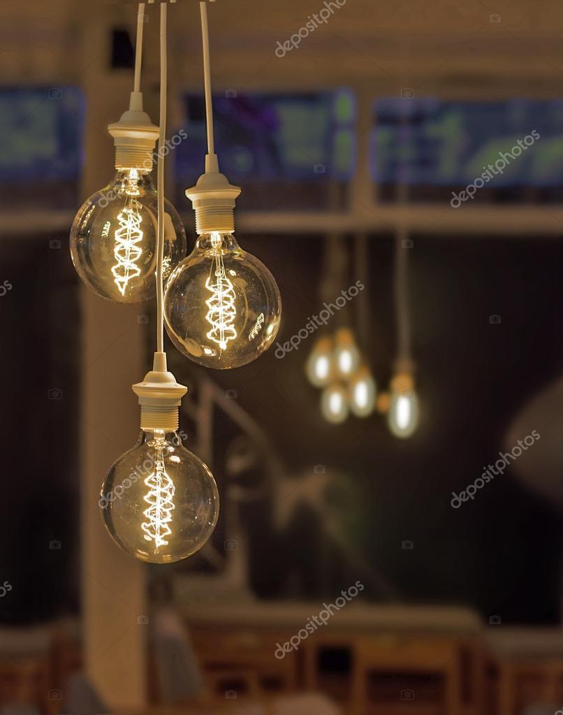 Retro style lighting decor with blur coffee shop background u2014 Stock Photo & Retro style lighting decor with blur coffee shop background u2014 Stock ...