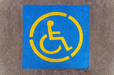 Handicap parking sign on asphalt, persons with disabilities