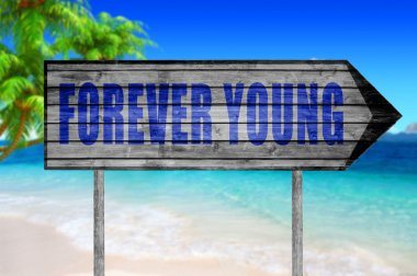Forever Young sign with on beach background