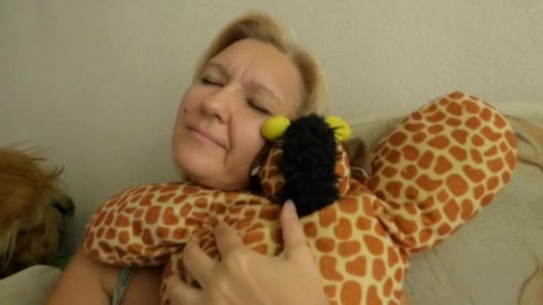 Soft toy in the hands of women