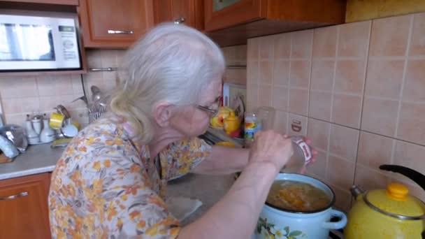 Grandmother cooks soup