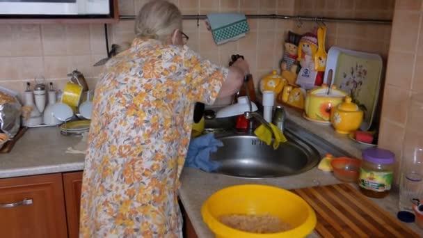 Grandma wipes her knife
