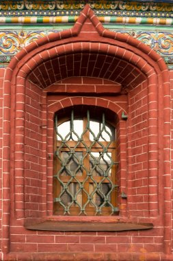 Window with the old grids, mosaics and moldings