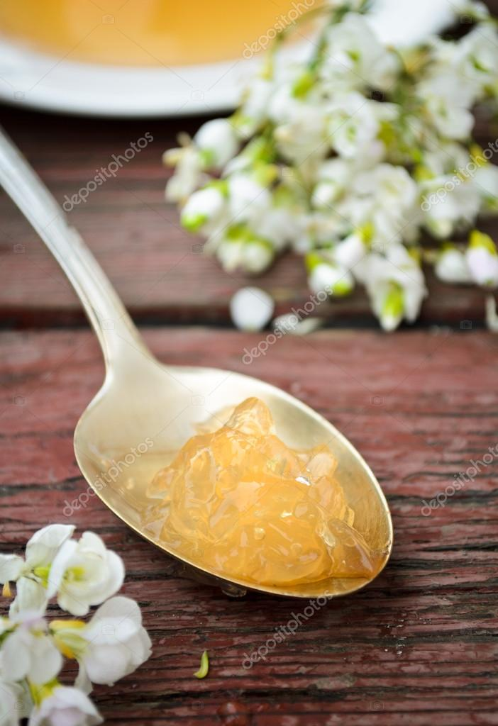 orange jelly with white flowers on wooden background