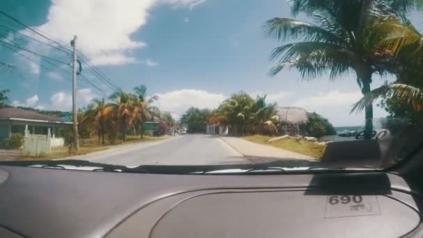 Driving though a tropical seaside town