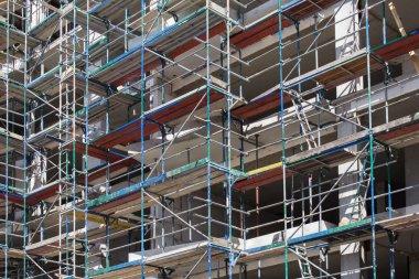 building facade with scaffolding - construction site