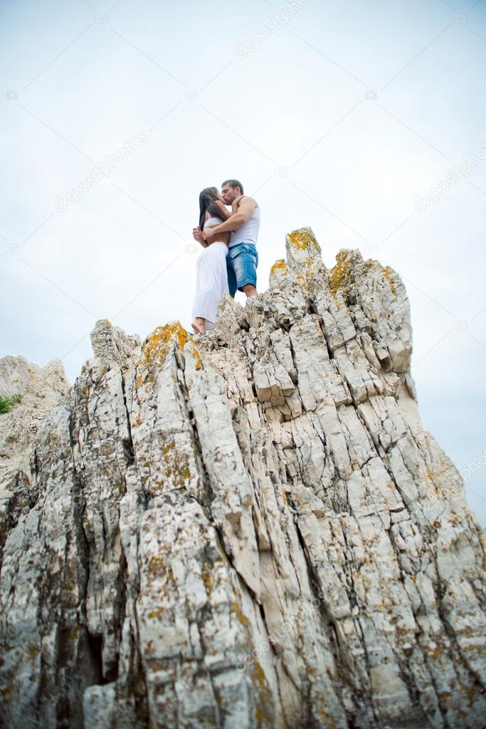 young lovers man and woman walking in the mountains