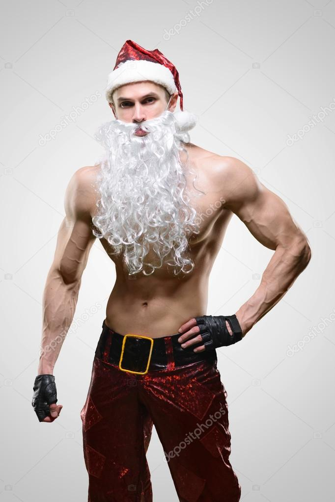 Muscular handsome sexy Santa Claus — Stock Photo