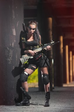 sexy military armed girl with the weapon