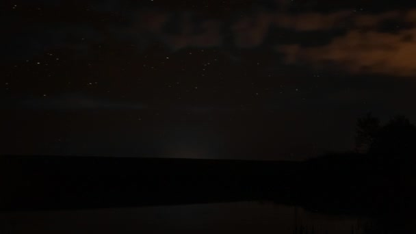 timelapse video of rotating stars in the night sky over rocky river and sunrise rotation of stars at night over lake nature sleeps, the time lapse twilight, beautiful stars night shooting stars
