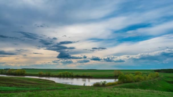 time lapse landscape clouds over lake beautiful view of the water recreation spring summer tide Nature wakes up pure white cloud moving fast in the sky wind beautiful picture background lake trees