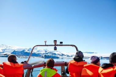 Sailing between icebergs in Jokulsarlon Lagoon, Iceland.