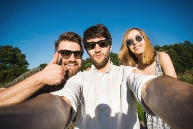 Friends do selfie in Central park